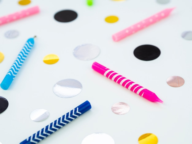 Close-up birthday candles and dots Free Photo