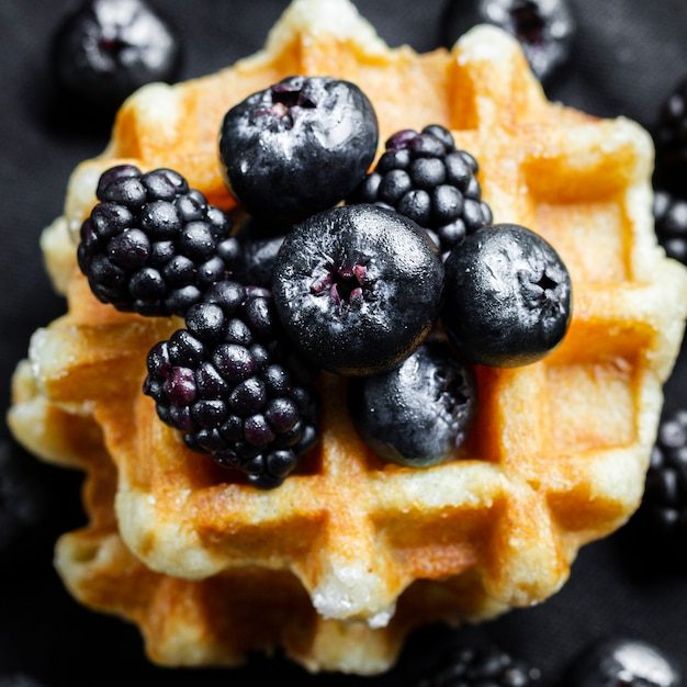 Close up black forest fruits on waffles Free Photo