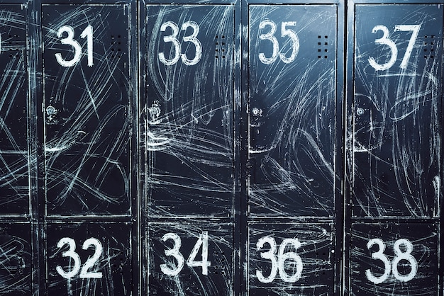 Close-up of black lockers with numbers Free Photo