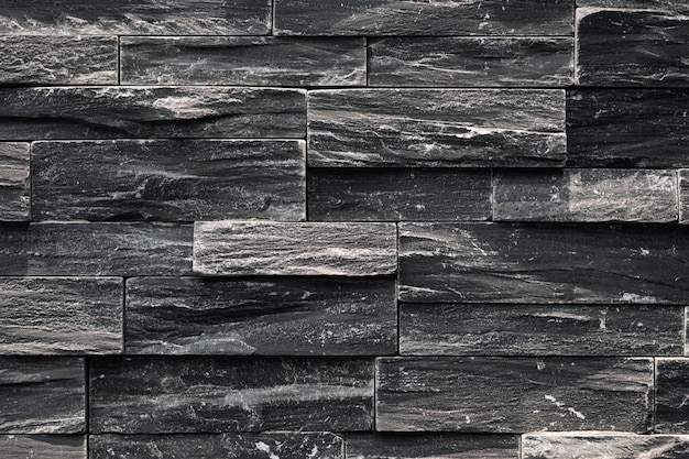 Close up of a black uneven wall Free Photo
