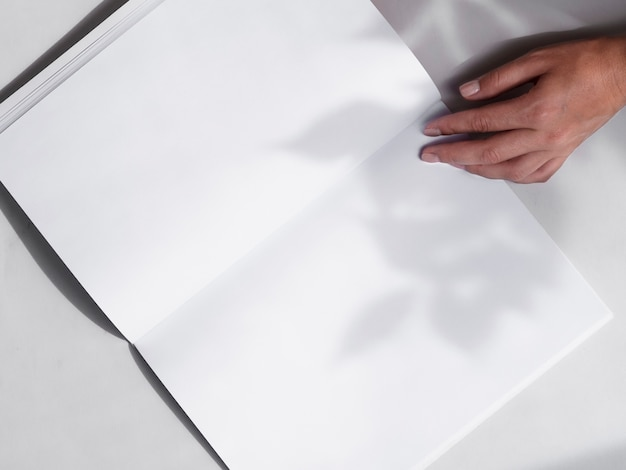 Close-up blank magazine held by a woman Free Photo
