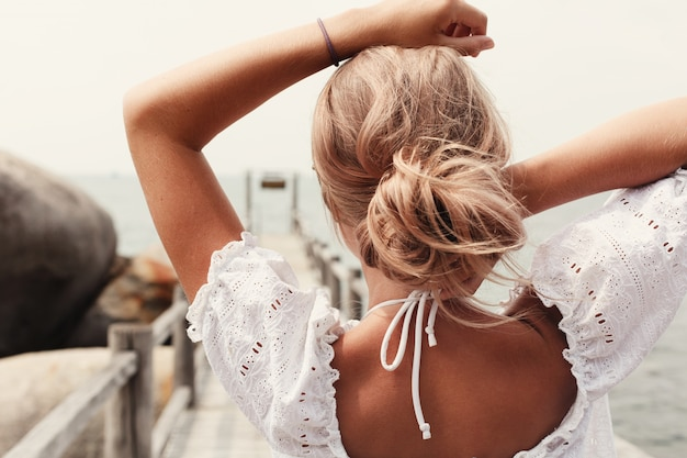 Close-up of blonde woman's back Free Photo
