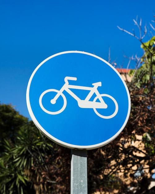 Close-up of blue bike lane sign Free Photo