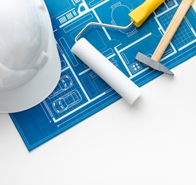 Close-up blue print and construction white hat Free Photo