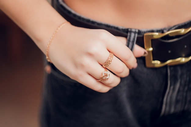 Close up of boho styled woman hands with silver jewelry. Premium Photo