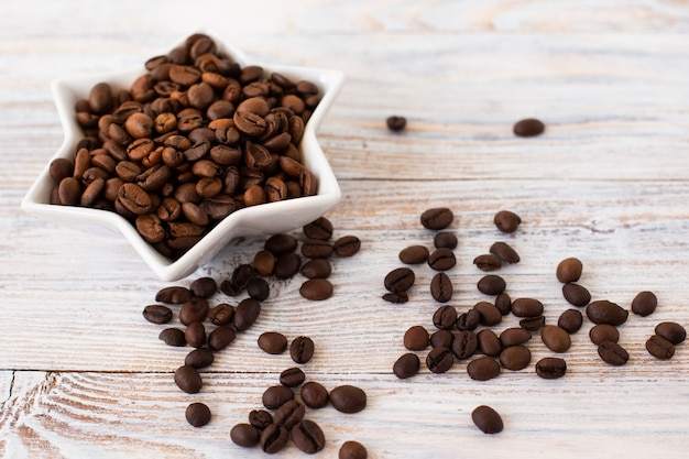 Close-up bowl filled with coffee beans Free Photo
