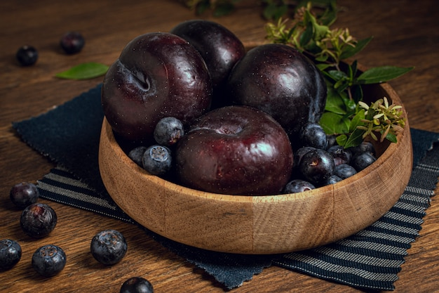 Close-up bowl full of plum fruit Free Photo