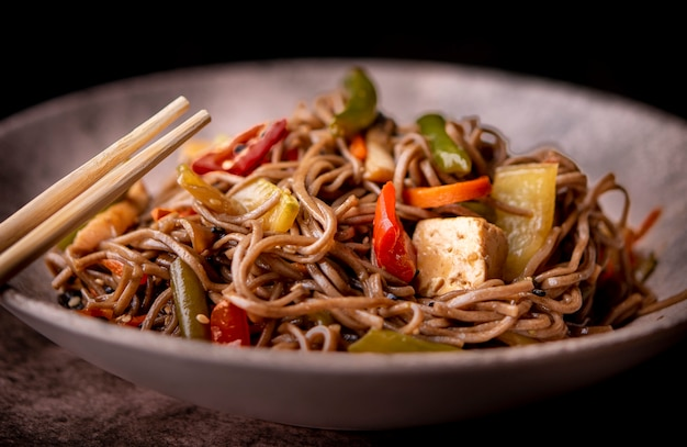 Close-up of bowl of vegetables and noodles Free Photo