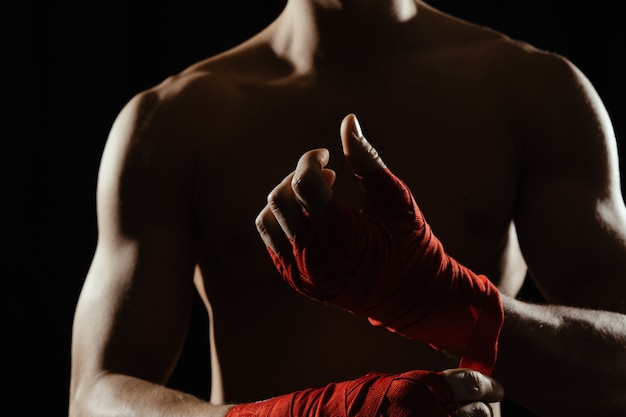 Close up boxer bandaging hands Free Photo