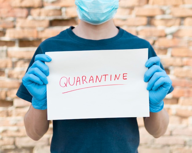 Close-up boy with paper sheet with quarantine Premium Photo