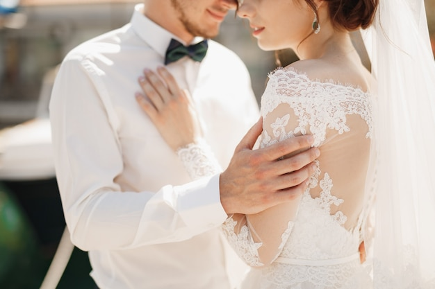 Close-up bride and groom are hugging tenderly Premium Photo