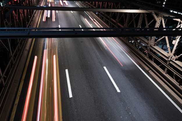 Close-up bridge with motion blur traffic Free Photo