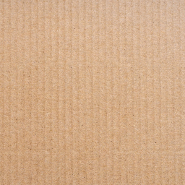 Close up brown cardboard paper box texture and background. Premium Photo