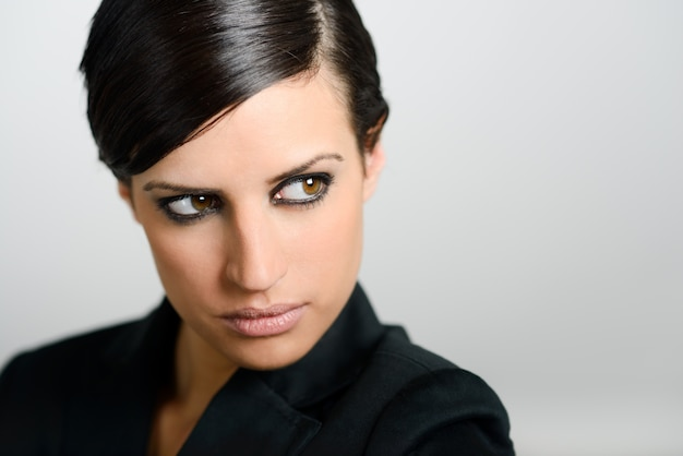 Close-up of brunette woman with intense look Free Photo