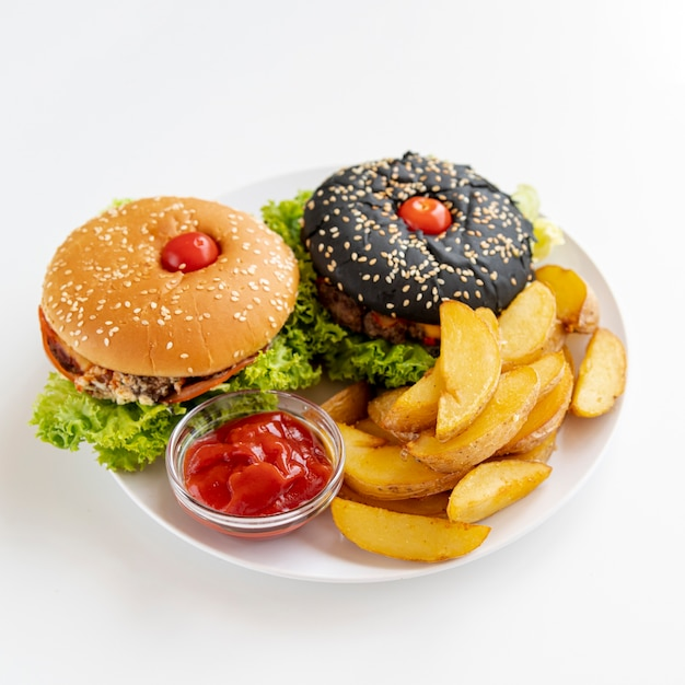 Close-up burgers with fries on plate Free Photo
