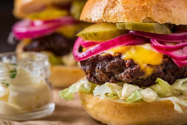 Close-up burgers with pickles Free Photo