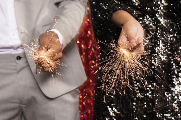 Close-up burning sparkler blast Free Photo