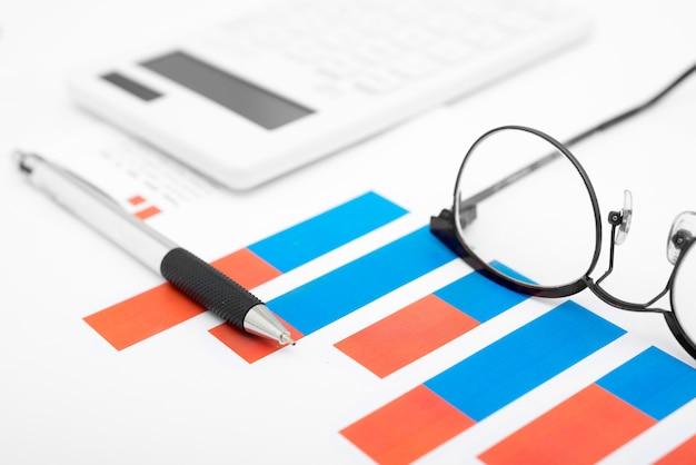 Close up business graphs with pen Premium Photo