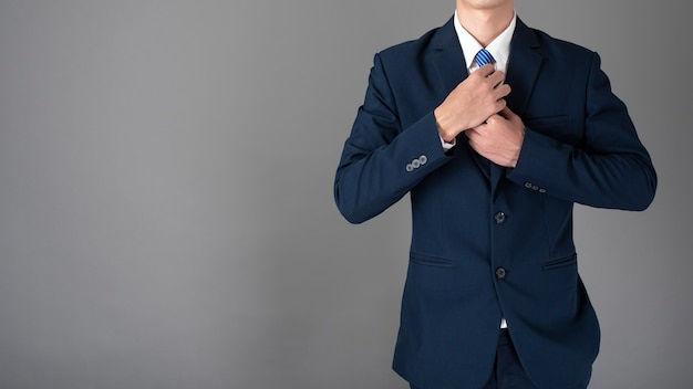 Close up of business man in blue suit is confident on gray background Premium Photo