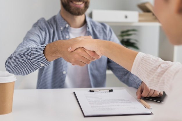 Close-up business meeting handshake Free Photo