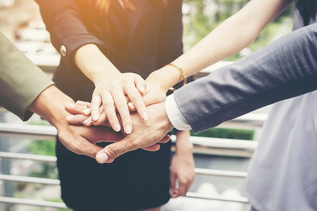 Close up of business people hands together. teamwork concept. Free Photo