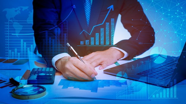 Close up of businessman is analyzing data in office Premium Photo