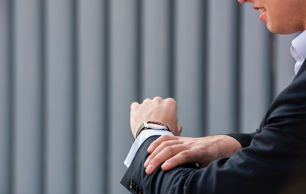 Close-up businessman looking at wrist watch Free Photo