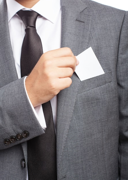 Close-up of businessman's hand taking a blank card Free Photo