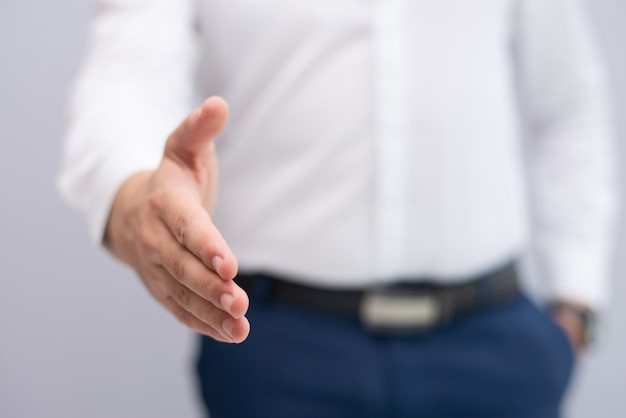 Close-up of businessman stretching hand for handshake Free Photo