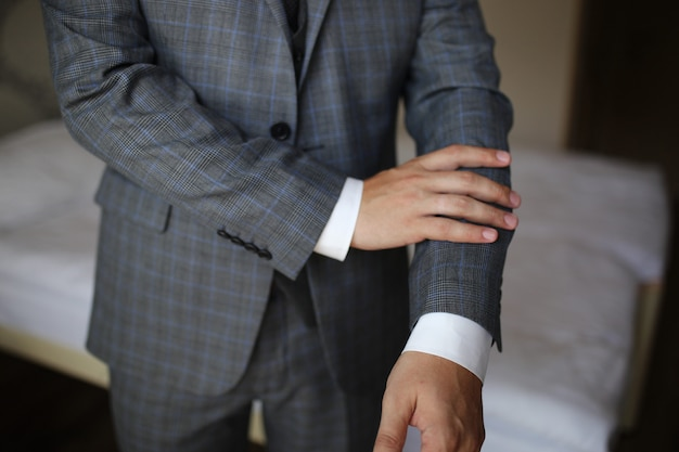 Close up of businessman in suit over dark gray background with copy space Premium Photo
