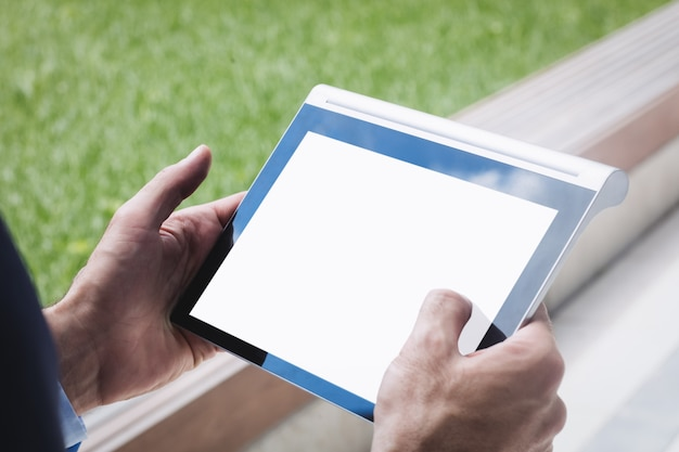 Close-up of a businessman using digital tablet Free Photo