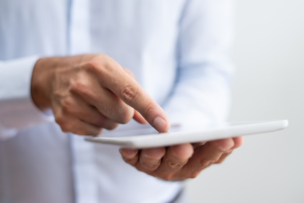 Close-up of businessman in white shirt pointing with finger Free Photo