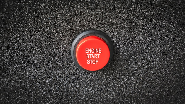 Close up on buttons with letters indicating starting the engine or electrical engine. Premium Photo