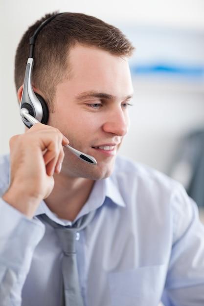 Close up of call center agent solving a costumers problem Premium Photo