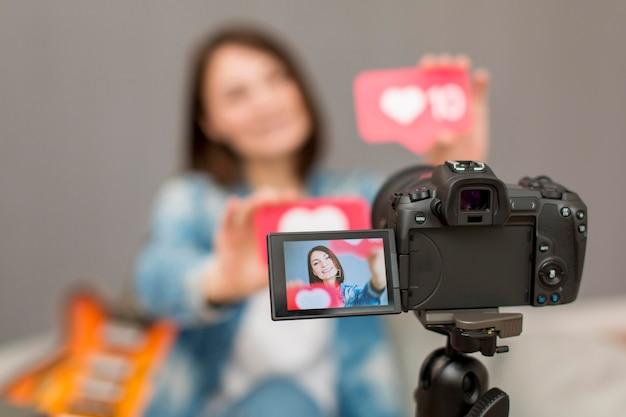 Close-up camera on tripod recording blogger Free Photo