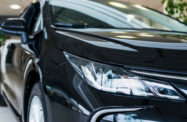 Close up of car in dealership Free Photo