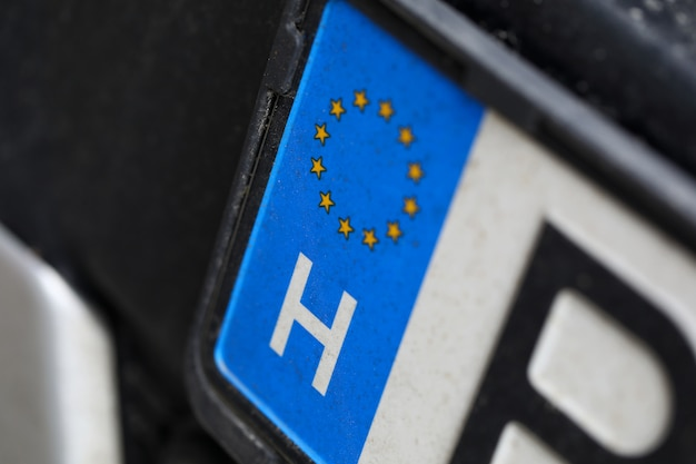 Close-up of car european license plate. automobile from eu. macro shot of registration number from european union. small stars placed in circle. vehicle and transport concept Premium Photo