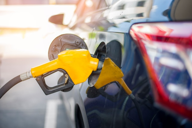 Close up of car is refilling oil fuel in gas station Premium Photo