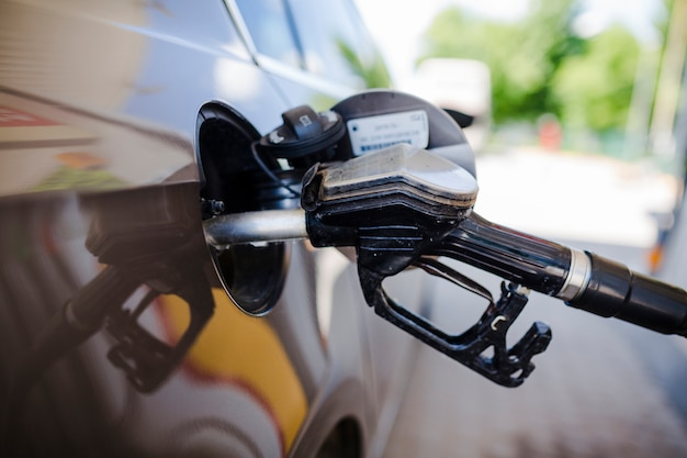 Close-up of a car refueling at petrol station Free Photo