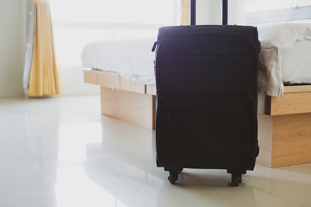 Close up carry-on luggage in the hotel room Premium Photo