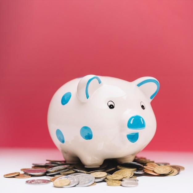 Close-up of ceramic piggybank over coins Free Photo