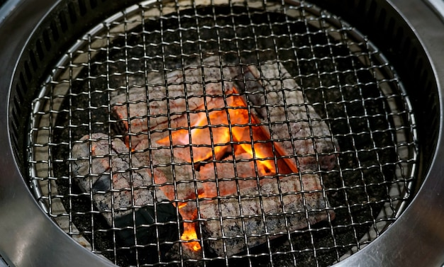 Close up of a charcoal grill and grilling basket. Premium Photo