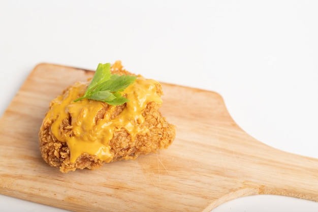 Close up a chicken fried topped cheese Premium Photo