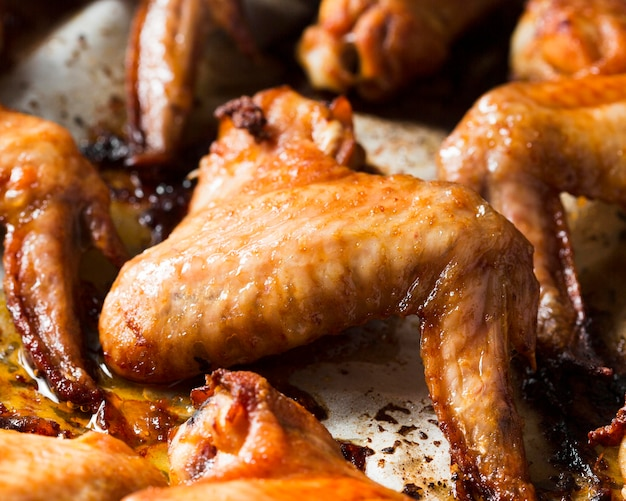 Close-up chicken wings in tray Free Photo