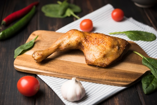 Close-up chicken on wooden board with ingredients Free Photo