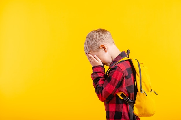 Close up on child covering his eyes with fear Premium Photo