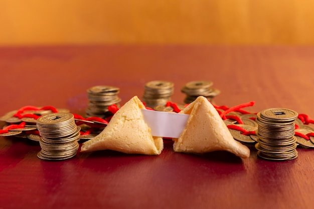 Close-up of chinese new year fortune cookie with coins Free Photo