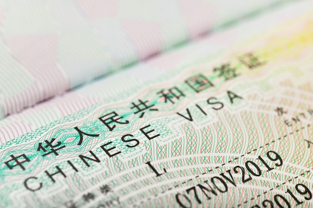 Close up of a chinese visa for travel in china background Premium Photo