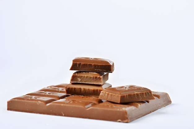 Close up a chocolate bar isolated on white background. Free Photo