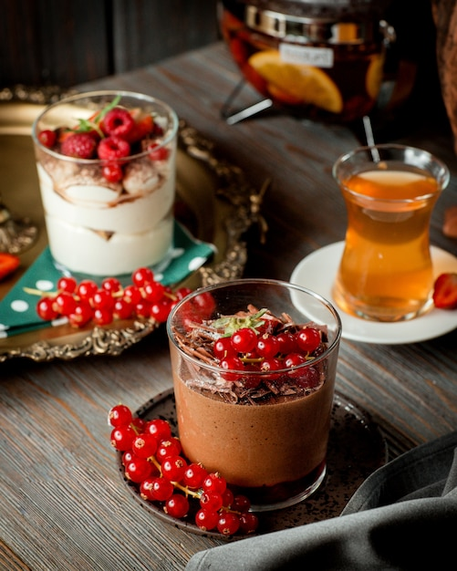 Close up of chocolate pudding garnished with berries Free Photo